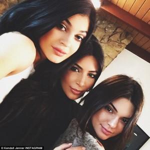 Kim Kardashian with her sisters
